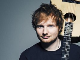 Ed Sheeran portrait holding acoustic guitar